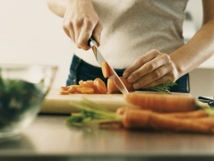 01-woman-chopping-vegetables-cutting-board-kitchen-lgn
